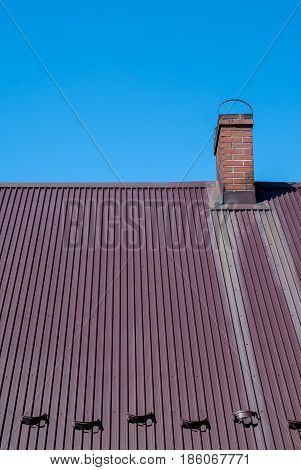 Metal Roof With Brick Chimney - Blue Sky As Background