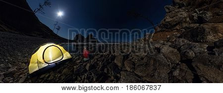 Cylindrical 360 Panorama Of  Man At  Tent On Stone Beach On Shore Of Lake Baikal At Night