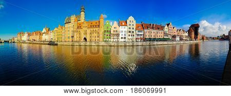 old town of Gdansk - panorama of Motlawa embankment with colorful gothic facades of old houses, Gdansk, Poland