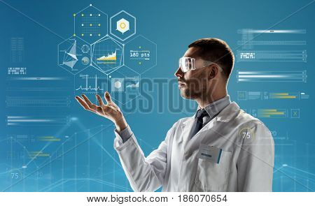 medicine, science, healthcare and people concept - male doctor or scientist in white coat and safety glasses touching something invisible over blue background