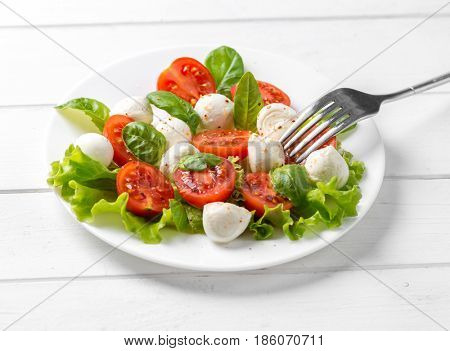 Nice big plate of delicious vegeterian salad with spinach and feta chesse, healthy eating