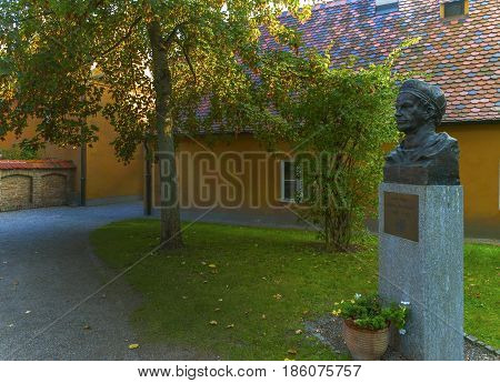 Augsburg, Germany - October 2016: Jakob Fuggerei monument at the streets of Fuggerei quarter