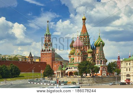View on Moscow Red Square, Kremlin towers, stars and Clock Kuranti, Saint Basil's Cathedral church. Hotel Russia Moscow Red Square Panorama. Moscow holidays vacation tours famous sightseeing points