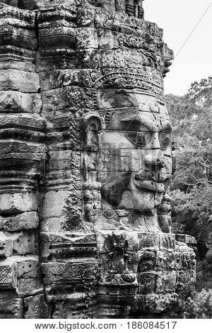 Smiling face on stone tower at Bayon temple in Siem Reap Cambodia