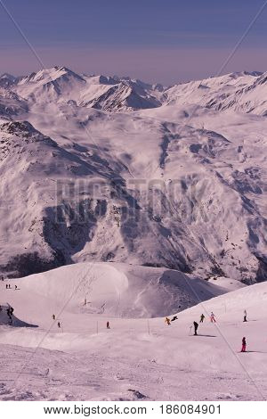 mountain landscape at winter with fresh snow on beautiful sunny day at french alps