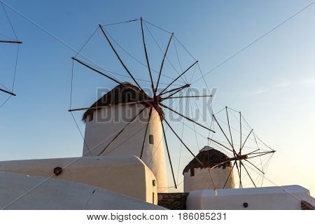 Amazing Sunset and White windmills on the island of Mykonos, Cyclades, Greece