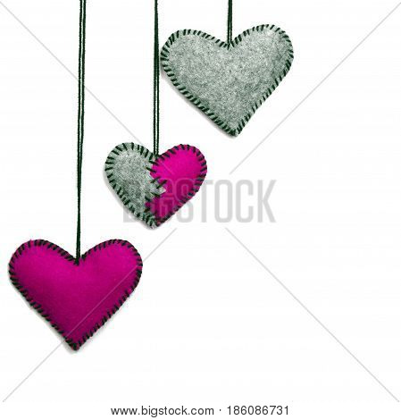 Three felt hearts on a white background valentines composition copy space
