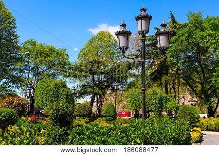 Green park near sulphur baths in old town of Tbilisi, Georgia and street light