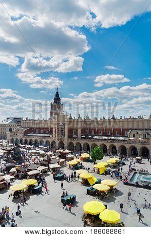 above view of Market square Rynek Glowny with Cloth hall Sukennice in Krakow, Poland