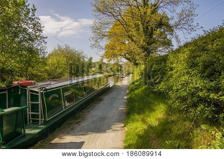 Chirk Wales UK - May 8 2017: A narrowboat moored up on a Summer evening on the Llangollen canal an idyllic getaway and alternative lifestyle on the waterway network