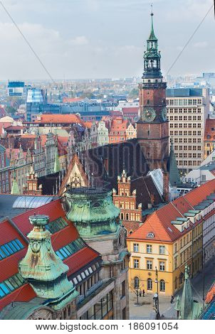 roofs and towers of Wroclaw - bird eye view of colorful roofs of old town with city hall tower, Wroclaw, Poland