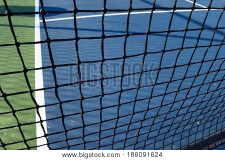 empty pickleball court and netting for playing