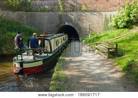 Chirk Wales UK - May 8 2017: A narrowboat makes its way through the 175m Whitehurst tunnel on a Summer evening on the Llangollen canal an idyllic getaway and alternative lifestyle on the waterway network