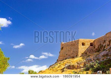 Fortezza Castle - Venetian fortress on hill Paleokastro in resort Rethymno. Greek architecture on coast of Kolpos Almirou. Leof. Emmanouil Kefalogianni Crete Greece