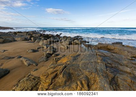 Rocky coastline with sea view on Four Mile Creek beach in Tasmania, Australia