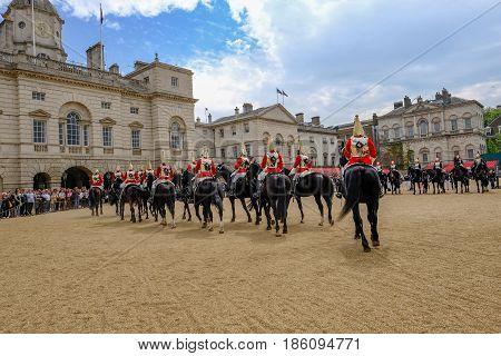 Horseguard's Parade London England - May 11 2017 : Guards on horses leaving Horseguard's Parade.