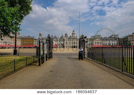Horseguard's Parade London England - May 11 2017 :Single policeman on guard watching over Horseguard's Parade where there is no entry.