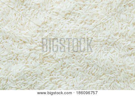 Close up grains of jasmine rice texture background.
