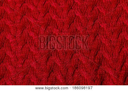 Detail of red wool knitted texture. Selective focus