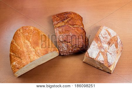 Freshly baked bread on wooden table top view