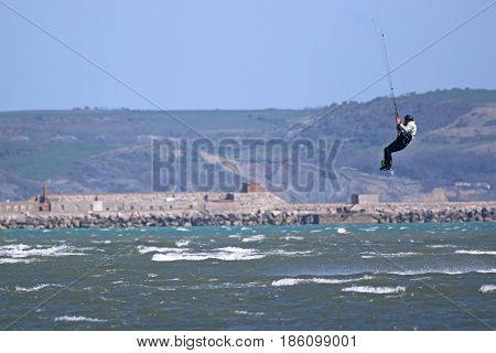 kitesurfer jumping on his board in Portland harbor