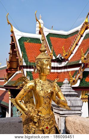 A golden statue in thai temple church