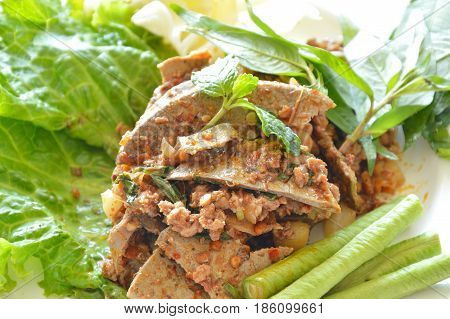 spicy minced pork and liver salad eat couple with fresh vegetable on plate