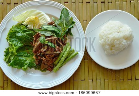 spicy minced pork and liver salad eat couple with sticky rice