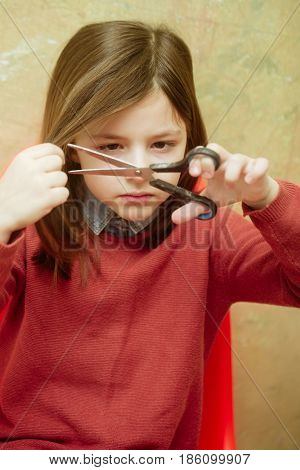 Girl Cutting Hair With Scissors