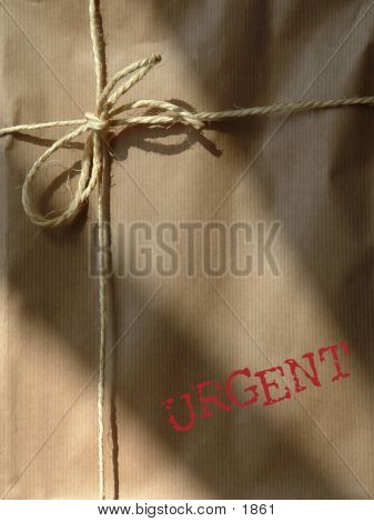 parcel with urgent on it poster