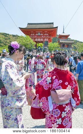 Kyoto, Japan - March 2016: Tourists Dressing Up In Traditional Kimono At Kiyomizu-dera Temple, Famou