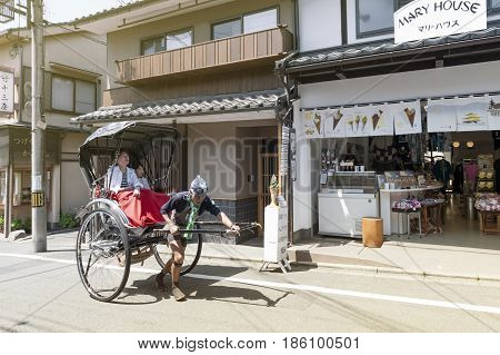 Kyoto, Japan - March 2016: Japanese Traditional Hand Pulled Rickshaw Carrying Tourists On Matsubara