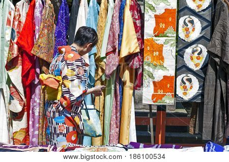Kyoto, Japan - March 2016: Lady Selecting Kimono From Colourful Collection In A Kimono Rental Shop O