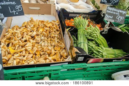 Chanterelle Mushrooms And Raw Fresh Asparagus For Sale At City Market. Lucerne, Switzerland