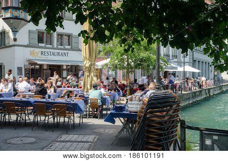 Outdoor Seating Restaurant On Central Street Of Lucerne, Switzerland