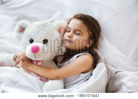 Little girl sleeping with her daddy a