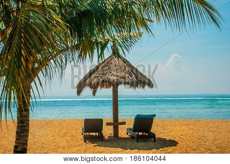 Sun Loungers And Parasols On The Beach. Bali, Indonesia, Tanjung Benoa. Nusa Dua.