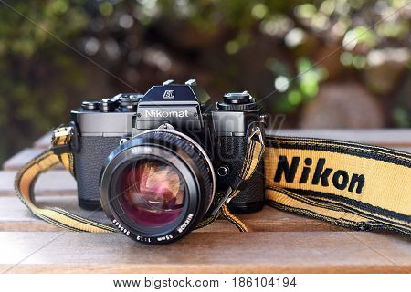VILNIUS - MAY 12: Nikomat EL vintage film camera with Nikkor 55mm lens on May 12 2017 in Vilnius Lithuania. Nikon Corporation specializing in optics and imaging products.