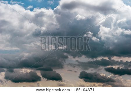 The Sun behind dark clouds. Grey clouds. Thunder Storm, Cloudy Day, Cloudy Weather,  Fresh Air.  Cloud Formations.