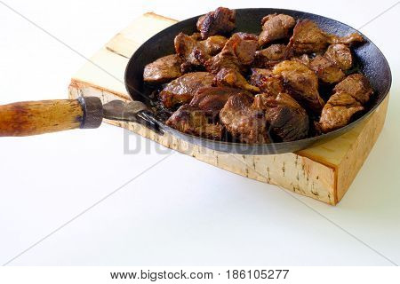 Cooking meat on an old vintage griddle