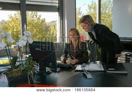 Woman Working At The Office Of Hugo Boss Industry