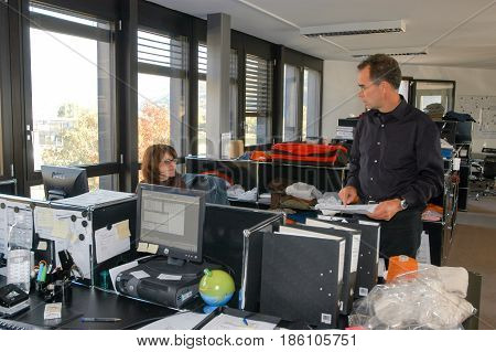 People Working At The Office Of Hugo Boss Industry