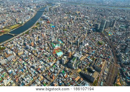 Aerial View of Tokyo Skytree and Sumida River Bridges. View from the highest tower in Tokyo. Sumida District, Japan. Daytime.