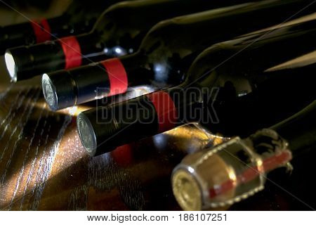 ageing of red wine in a cellar with weak light and a light beam