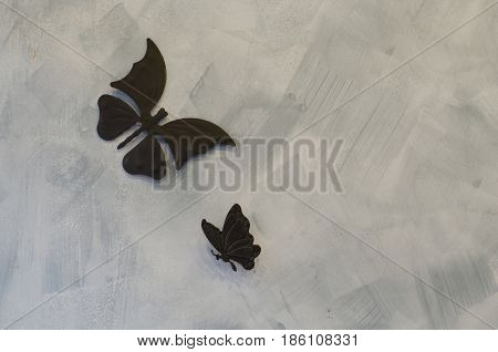 Iron butterfly on cement background, steel butterfly