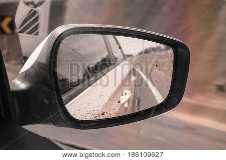 Inside View Of A Muddy Car Rear View Mirror