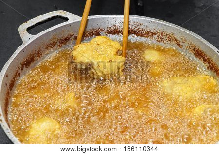 Frying Fish In A Pan With Boiling Oil