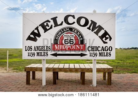 Adrian Texas - July 9 2014: Welcome sign marking the midpoint between Chicago and Los Angeles in the historic Route 66 in Adrian Texas USA.