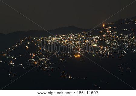 Beautiful night image of Darjeeling Queen of Hills as seen from Okhrey Sikkim India