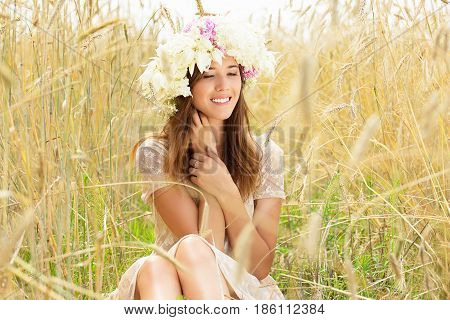 Happy Adolescence. Portrait Of Smiling Beautiful Young Woman Dressed In White Dress And Flowers On H